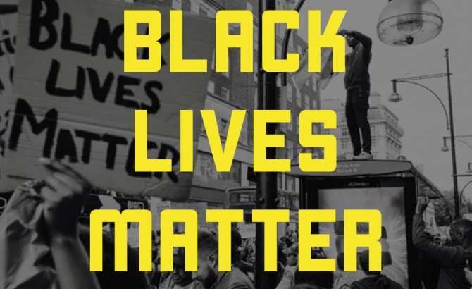 Description: The words Black Lives Matter in large yellow font on a black and white photograph of people at a protest. Image from blacklivesmatter.com.